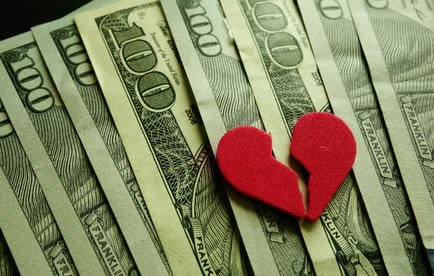 Broken heart image with cash in background